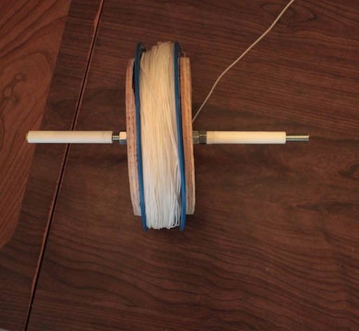 Straight angle above string winding contraption