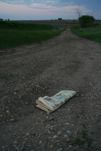Gone but not forgotten: newspaper left at an abandoned property